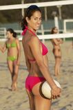 Beach volleyball player in bikini holding ball Royalty Free Stock Photography