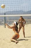 Beach volleyball player diving for volleyball Stock Photos