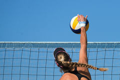 Beach volleyball player jumps Stock Image
