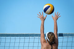 Beach volleyball player jumps on the net Royalty Free Stock Photo