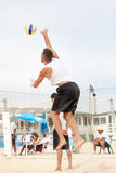 Beach volleyball player man, players men. Men beach volleyball players. Italian national championship. 29 June 2015. Location: Ostia (near Rome), Italy. Attack Stock Image