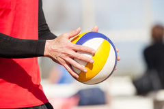 Beach volleyball player, playing summer. Hands with ball. A person holding a beach volley ball in hands. Beach volleyball is a game very popular in summer, on Royalty Free Stock Image