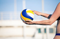 Beach volleyball player, playing summer. Woman with ball. A woman body holding a beach volley ball in hand. Sky in the background. Beach volleyball is a game stock photos