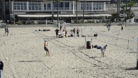 Beach volleyball players in Huntington Beach stock footage