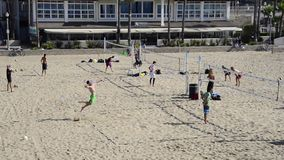 Beach volleyball players in Huntington Beach stock video
