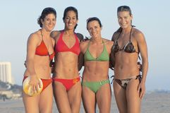 Beach volleyball players standing on beach Royalty Free Stock Photos