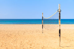 Beach Volleyball on sandy beach with sea and blue sky in the bac Royalty Free Stock Photography