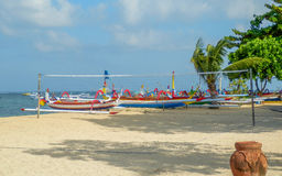 Beach Volleyball, Sanur Beach. Beach Volleyball with traditional Indonesian fishing boats Stock Images