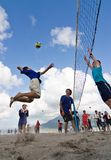 Beach Volleyball spike. Kagoshima City, Japan, July 6, 2007. A male volleyball player jumps to spike while another prepares to block during a beach volleyball royalty free stock photography