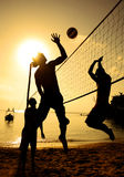 Beach Volleyball Sunset Holiday Team Concept Stock Image