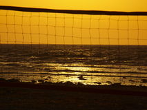 Beach volleyball and sunset Stock Images