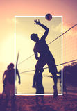 Beach Volleyball at sunset Playing Sport Concept Stock Photos