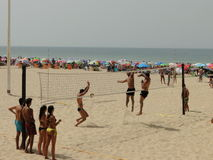 Beach volleyball. Teams of sportsmen playing volleyball on the beach Stock Image