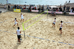 Beach Volleyball. Beach volley at Brighton UK. Related links are with sport, teamwork, seaside resorts, fitness, leisure activities and re-generation of seaside Stock Photography