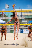 Beach volleyball women players. Jump Stock Photo
