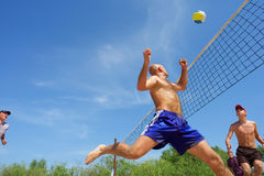 Beach volleyl balding man runs Stock Image