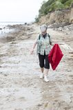 Beach walk. A woman at the beach walk in the rain Royalty Free Stock Photos