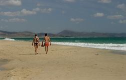 Beach walk. Walking the beach on spanish Island Fuerteventura royalty free stock images