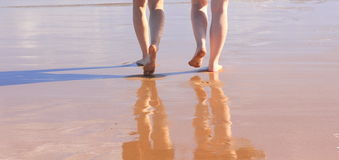 Beach Walk Barefoot In Wet Sand, Two Woman In Holidays Stock Image