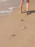 Beach walk with footprints Royalty Free Stock Photos