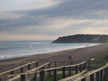 Beach walk. On overcast day with gentle surf; Lawrencetownbeach; Nova Scotia Royalty Free Stock Images