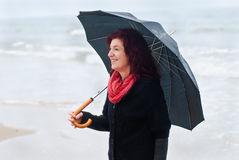 Beach Walk with Umbrella Royalty Free Stock Images