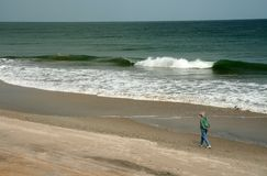 Beach walker Royalty Free Stock Photo