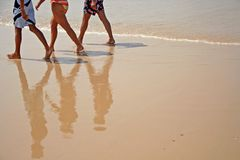 Beach walkers. People (legs only) walking on the beach stock photos