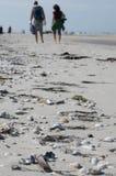Beach walkers Stock Image