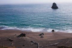 Beach walkers in California north coast Stock Image