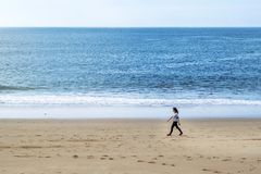 Beach walking young lady stock photography