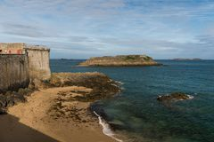 Beach, wall and fort in Saint-Malo on a sunny day in summer. Beach, wall and fort in Saint-Malo Brittany, France on a sunny day in summer stock images