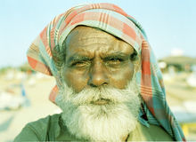Beach walla, South Anjnia Goa India. Beach walla south Anjunia Goa India i found this old man on the beach hustling tourists for money i just loved his face i Stock Image