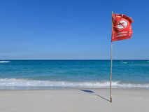 Beach with warning flag. Because of dangerous currents, Rio de janeiro, Brazil Stock Image