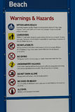 A beach warning and hazards sign with regulations.  stock photography