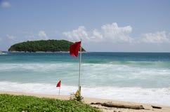 Beach warning red flags at Nai Harn beaches of Phuket Stock Image