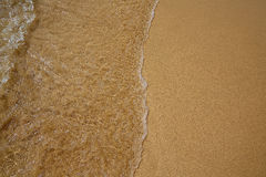 Beach water and sand texture background Stock Photo