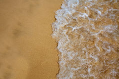 Beach water and sand texture background Stock Images