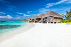 Beach and water villas on a small island resort in Maldives, Indian Ocean. Royalty Free Stock Photos