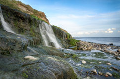 Osmington Mills. The beach and waterfall at Osmington Mills near Weymouth on Dorset's Jurassic Coast Royalty Free Stock Photography