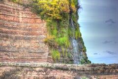 Beach waterfall St Audries Bay Somerset England uk in colourful HDR. St Audries Bay Somerset England uk near Watchet in colourful HDR Stock Images