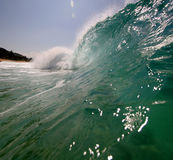 Beach wave. A wave breaking along the sea shore Royalty Free Stock Images