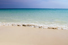 Beach and wave of blue ocean on sand summer background. Tropical beach with white sand and beautiful blue sky background summer Stock Photography