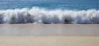 Beach wave closeup Stock Image