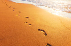 Beach, wave and footprints Royalty Free Stock Photo