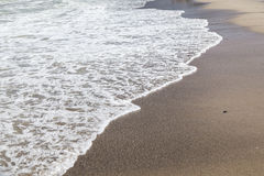 Beach with wave and sand at the morning. Wave on beach Royalty Free Stock Images