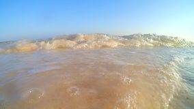 Beach wave. Before sunset with blue sky and white sand in Bulukumba Sulawesi Selatan Indonesia stock video footage