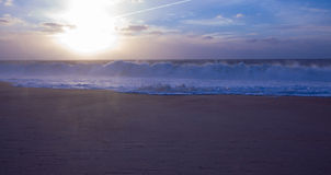 Beach wave. In the sunset and sunrays Royalty Free Stock Photo