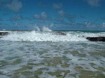 Beach waves. Waves on beach in Barbados Stock Photos