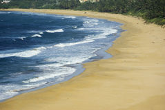 Beach & Waves. Sandy beach with golden sand and ocean waves stock photography